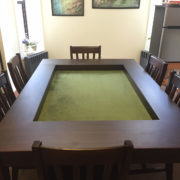 Dining Game Table with 6 chairs in Sagamore Hill and Forest Green. Photo by Sean.