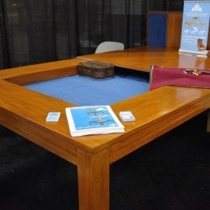 Tablezilla in French Couture finish and Dark Blue fabric. Note there are 2 pieces to the top: the second piece is propped up behind the table. Photo from PAX South 2016.