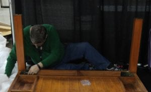 Clint attaches the legs to the table. Note the three bolts and steel plate construction. Now that's a sturdy table!